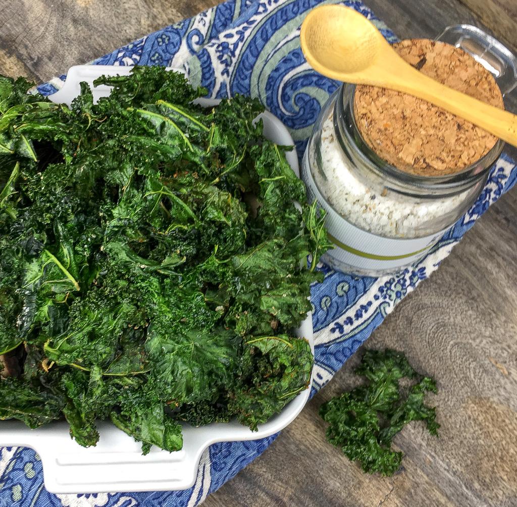 crispy kale chips in square serving dish.